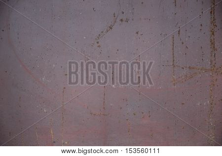 Rusty metal texture with scratched surface. Old painted metal wall with peeling paint. Texture obsolete painting metal fence close-up