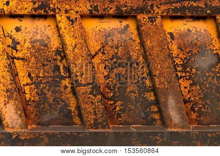 Texture Of Rusty Metal. A Fragment Of The Body Of The Old Truck.
