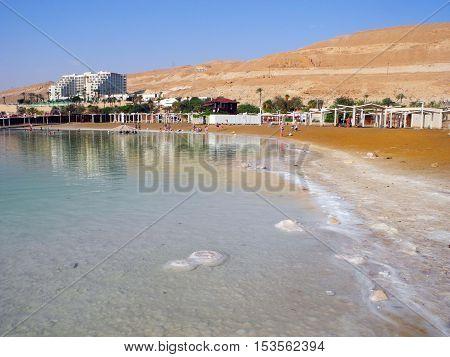 Ein Bokek Israel - August 23 2016: Vacationers on the beach of the Dead Sea resort.