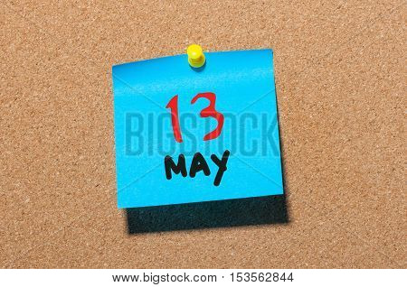 May 13th. Day 13 of month, calendar on cork notice board, business background. Spring time, empty space for text.