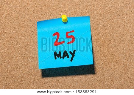 May 25th. Day 25 of month, calendar on cork notice board, business background. Spring time, empty space for text.