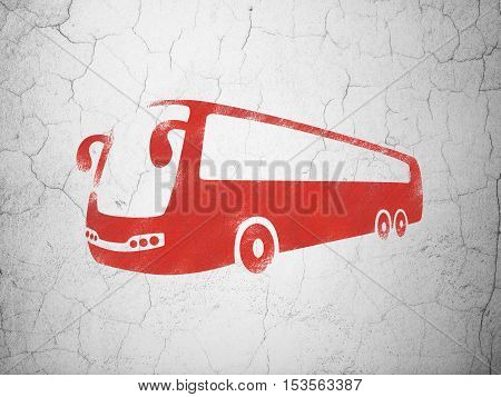 Travel concept: Red Bus on textured concrete wall background