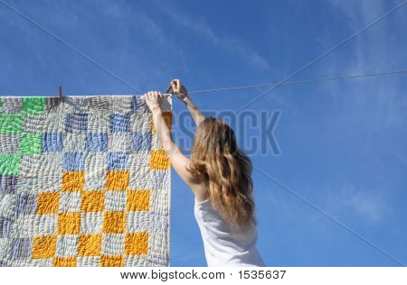 Longhaired Girl And Bright Laundry