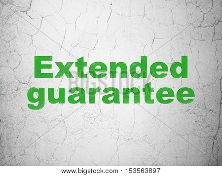 Insurance concept: Green Extended Guarantee on textured concrete wall background