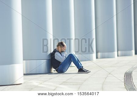 little boy crying on the street negative emotion
