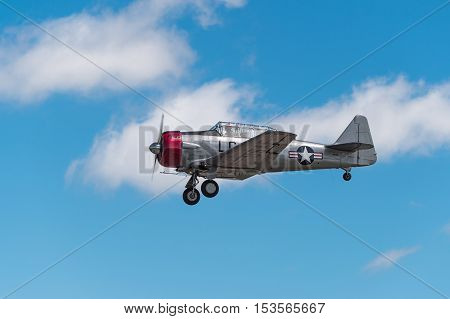 EDEN PRAIRIE MN - JULY 16 2016: AT-6 Texan airplane comes in for a landing with gear down at air show. The AT-6 Texan was primarily used as trainer aircraft during and after World War II.