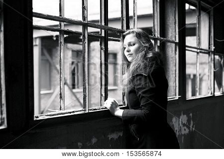 beautiful woman in ruined building looking at window sad, lifestyle people concept