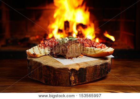 delicious piece of meat roasted on a background of fire