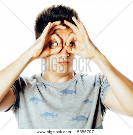 young pretty man isolated showing two ok signs smiling close up on white background