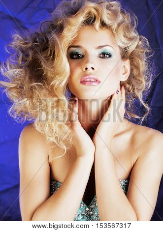 young blonde woman with glamour makeup and hairstyle waves close up, pink lipstick, beauty concept