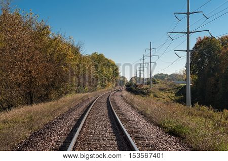 Train Tracks Curve to Distance - power lines to right