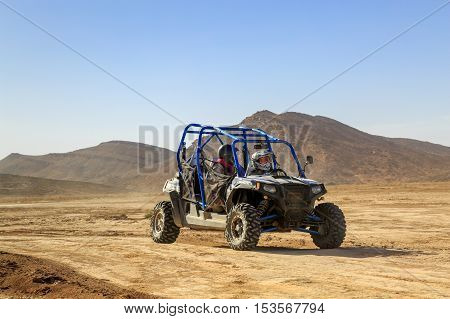 Merzouga, Morocco - Feb 24, 2016: Blue Polaris Rzr 800 And Pilots In Morocco Desert Near Merzouga. M