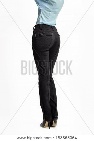 Fashion female concept. Woman full length in trousers high heels shoes classical style. Back view, isolated on white background