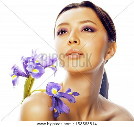 young pretty real asian woman with flower purple orchid close up isolated on white background spa, healthcare concept