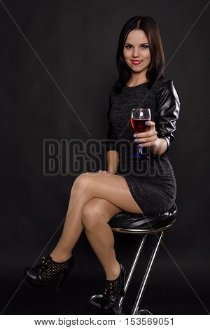 Girl In A Black Dress Drinking Wine