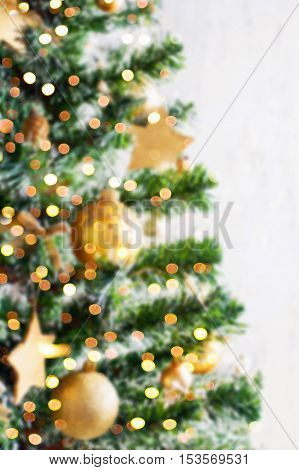 Christmas Golden Ornaments On Blured Tree Closeup