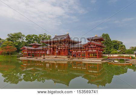 UJI JAPAN - JULY 27 2016: Phoenix Hall (Hoodo circa 1053) of Byodo-in Temple in Uji city near Kyoto. National Treasure of Japan and UNESCO site