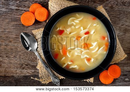 Traditional Chicken Noodle Soup, Overhead Scene On A Rustic Wooden Background