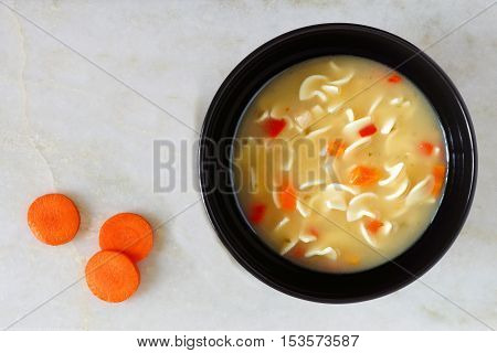 Traditional Chicken Noodle Soup, Overhead View On White Marble Background