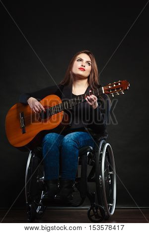 Disabled Girl Playing Guitar.