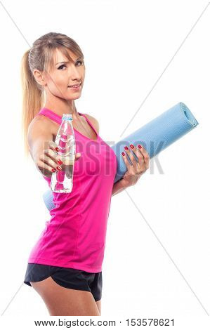 sport concept -beautiful slim sporty woman with yoga mat and water isolated on white background.