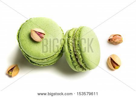 Delicious Macaroons With Pistachio On White Background
