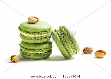 Small Macaroons With Pistachio On White Background