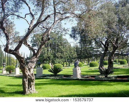 Sculptures in the trees in Bahai garden near Akko Israel November 17 2003