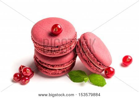 Tasty Macaroons With Red Currant On White Background
