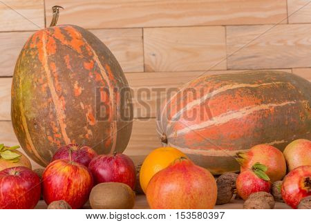 Autumn nature fruits concept. Fall fruits on a wooden table, studio picture