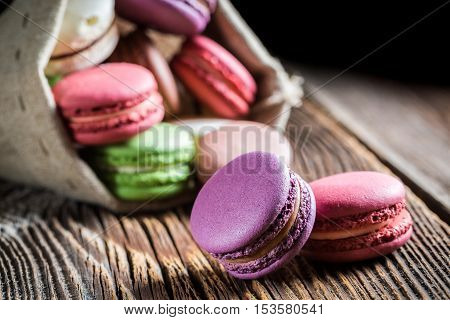 Closeup of tasty macaroons on wooden table