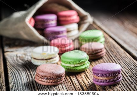 Closeup of fresh macaroons on wooden table