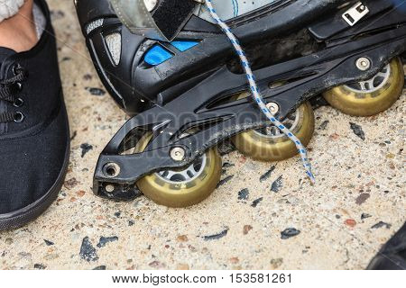 Closeup of roller skates blades outdoor. Sport equipment.