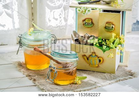 Healthy honey with linden on old white table
