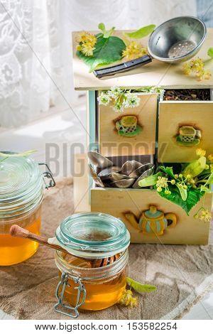 Fresh linden honey on old white table