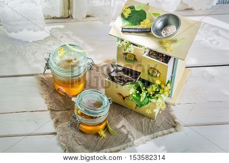 Sweet linden honey on old white table
