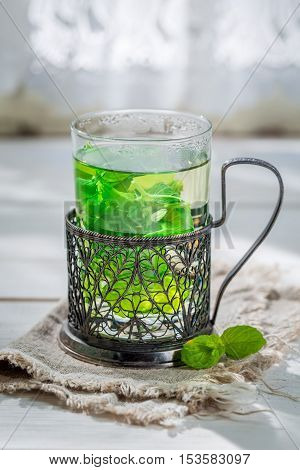 Sweet Mint Tea With Honey In Sunny Day