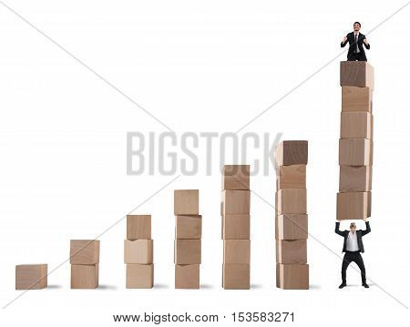 Businessman rejoices on the last step of the statistical lifted by a colleague
