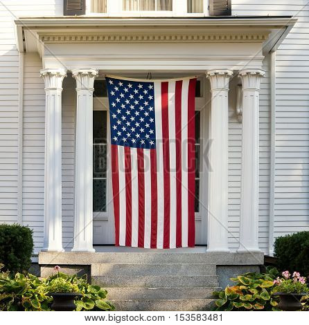 American flag displayed on the door of New England home