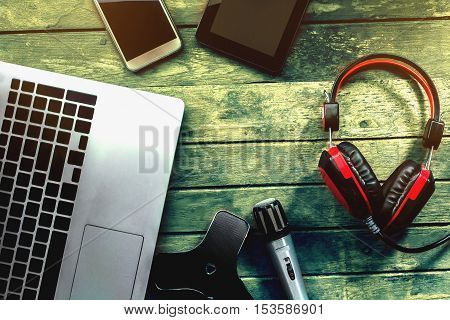 Tools and equipment to record analog and digital background wooden.