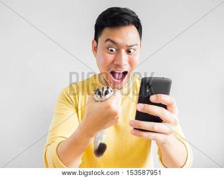 Man Plays Mobile Game.
