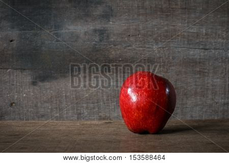 single ripe apples on wooden background ,Red Apple fresh