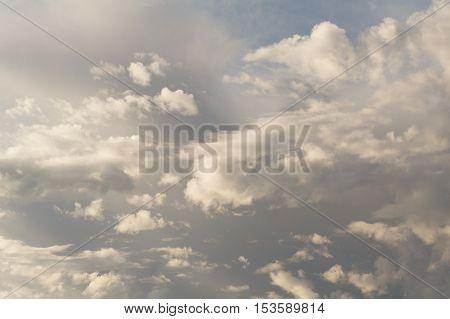 Cumulus clouds against a blue sky. Mostly Cloudy. Synoptics.