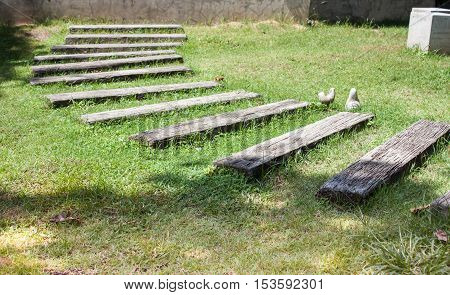 Old wooden pathway in garden, stock photo