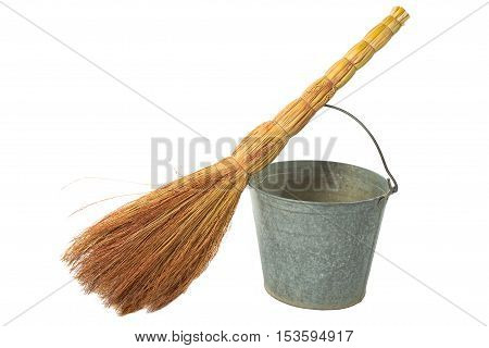 Old antique vintage traditional Soviet a bucket a broom. House cleaning service.