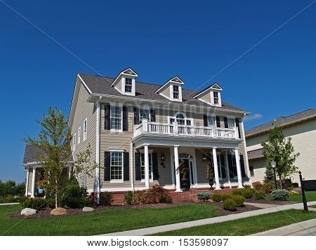 Carmel, Indiana, USA, September 15, 2009:  NewConstruction,  large two-story tan home styled to look like an historic house.