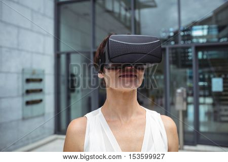 Woman using reality virtual headset in office building