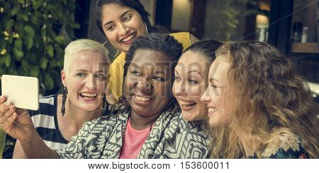 Group Of Women Taking Pictures Concept