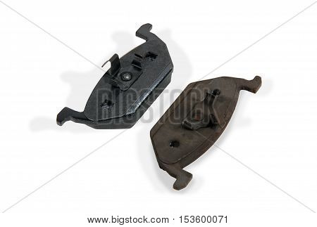 one new and one old brake pad for car