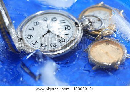 Few watches closeup under frozen water background